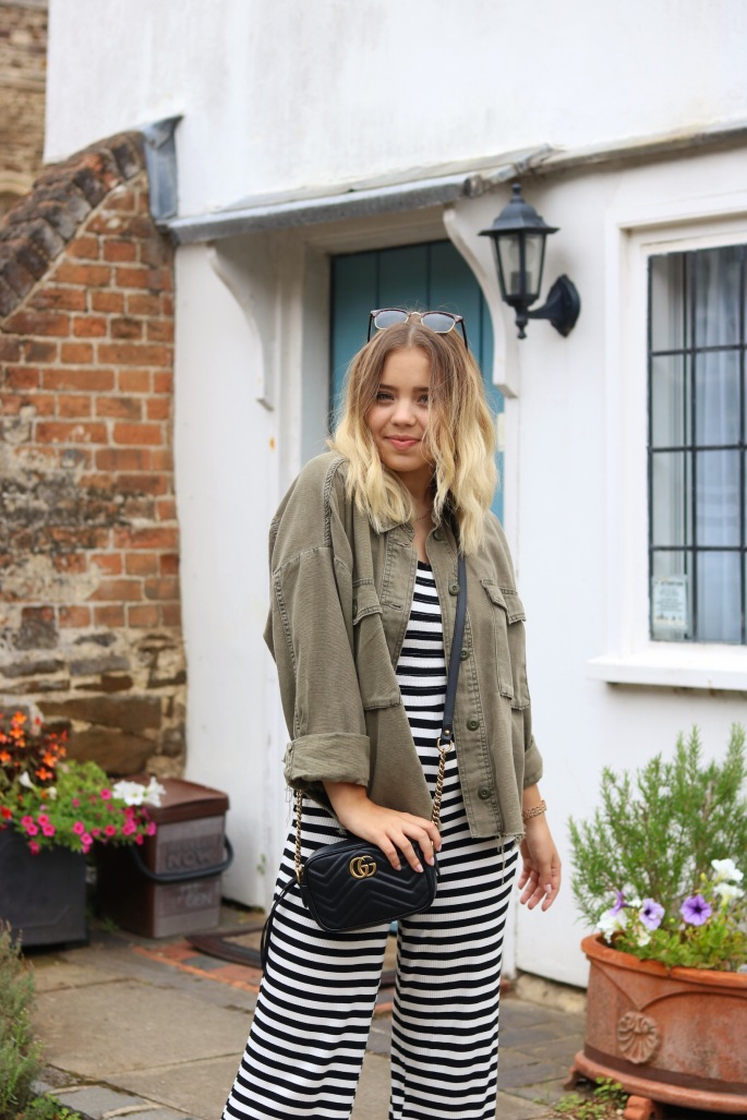 A fashion & lifestyle blogger wearing casual Topshop clothing
